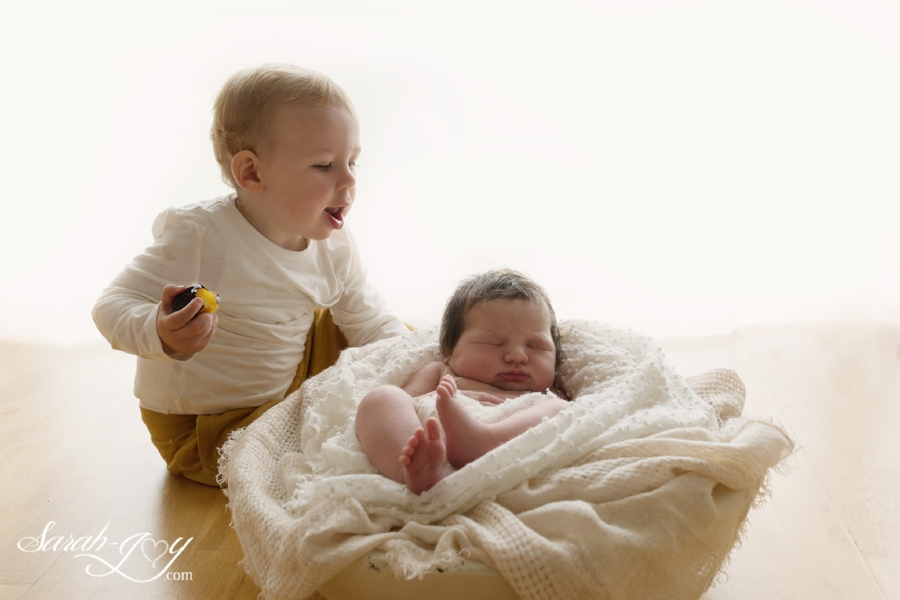 Newborn baby and toddler sibling photo in studio