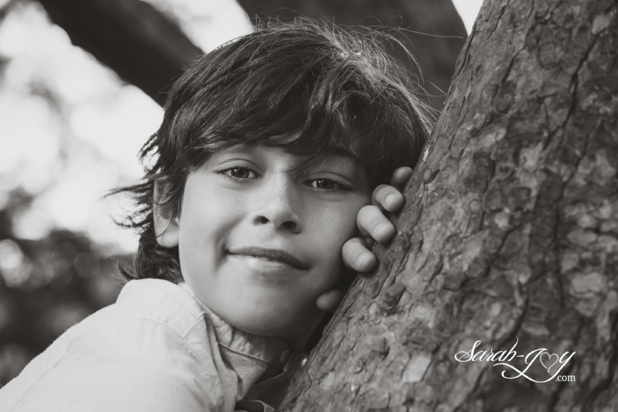 Child sitting in a tree in melbourne