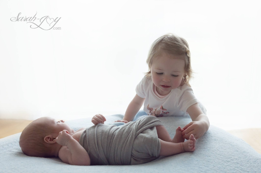 Newborn baby and sibling photo