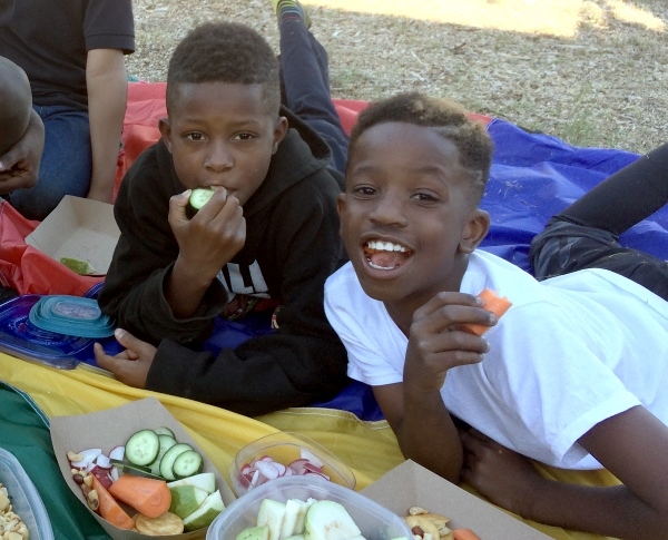 Isiah and his buddy Jordan are there at the urban farm in California, enjoying veggies at the Garden Club, our program that's turning young kids into ambassadors of healthy food for their families 12/8/16
