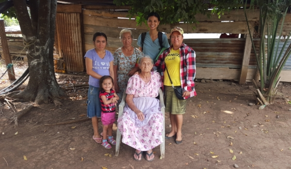 The little girl is Sara, who suffers from severe stunting (she's 3 1/2 years old but only as tall as an average 2 year old; she just recently learned to walk, and has yet to learn to talk), Sara's mom is behind her, Grandma is standing to Ruth's right, and Great-grandma is seated, in front.