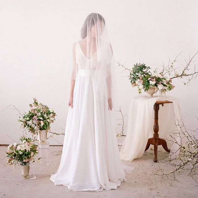 Veil and dress @mespetitesdentelles | photo by @audrawrisleyphoto | floral design and styling @elizabeth.trenti | beauty @lorinansi | model @ceciliashi | film Scan @richardphotolab
