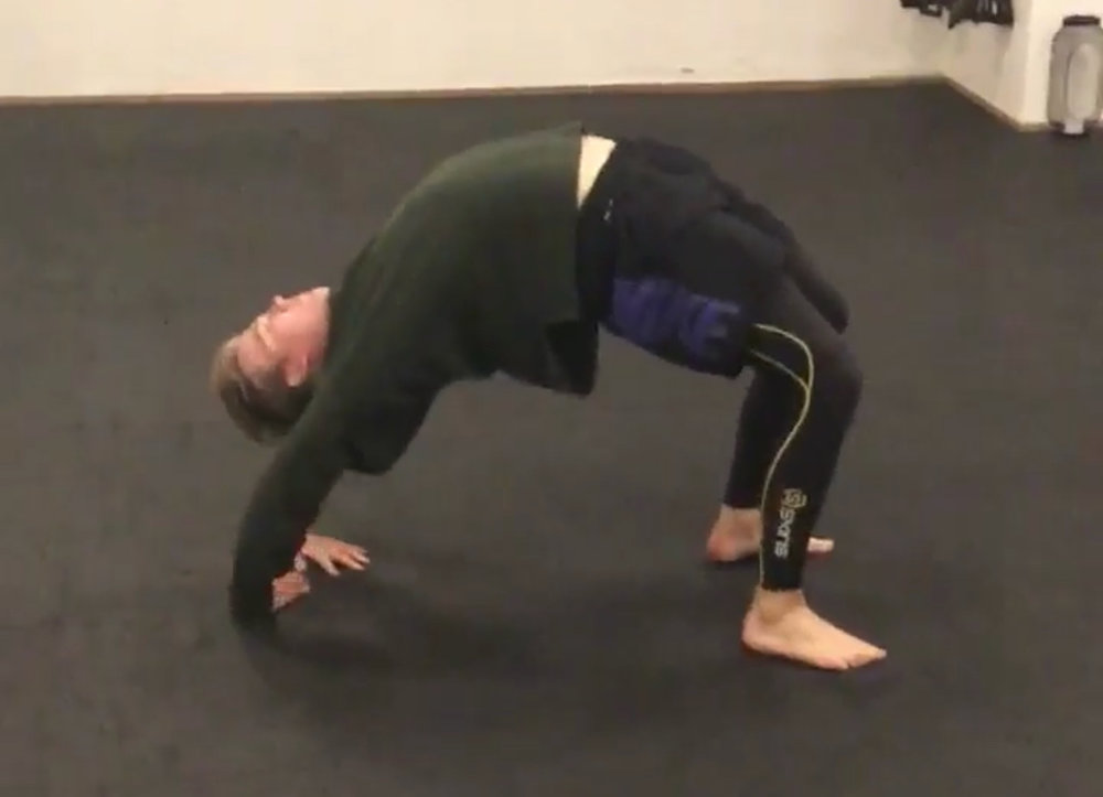 """Viktor Sundin - """"One of my Mobility goals when I started training with David was to improve my Bridge. He gave me a new understanding of the move and knew exactly how to get me there. By smart programing and progressions customized for my current level my bridge have never been better!"""""""