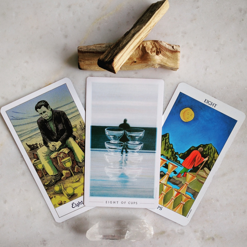 8 of Cups from the following decks: Cosmic Tarot, Fountain Tarot, RWS Radiant Tarot