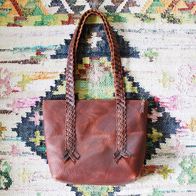 Refining some designs just in time for @columbus_flea this Sunday!  1974 purse with an inside pocket, zipper top, and signature braids. . . #leatherbag #lisahernandez #columbusflea #shop614 #asseenincolumbus #bohostyle
