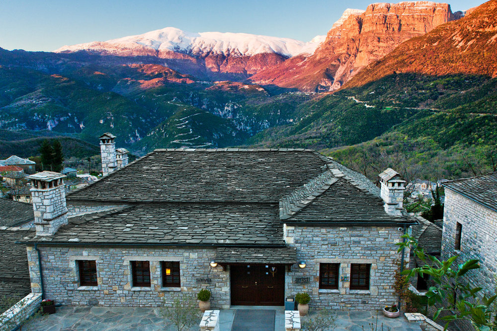 In the Pindus mountains, this rustic-chic, stone-built resort is 5 km from Moni Panagias church and 13 km from Vikos Gorge.   Modern rooms and suites, with stone and wood accents, feature minibars, free Wi-Fi and flat-screen TVs, as well as lounge areas and balconies. Upgraded suites add fireplaces and living rooms. There are also 2-bedroom villas with kitchens.  Amenities include a restaurant, a bar, and a warm lounge with a fireplace. There's also a spa area with a sauna and an indoor pool. Parking is free.