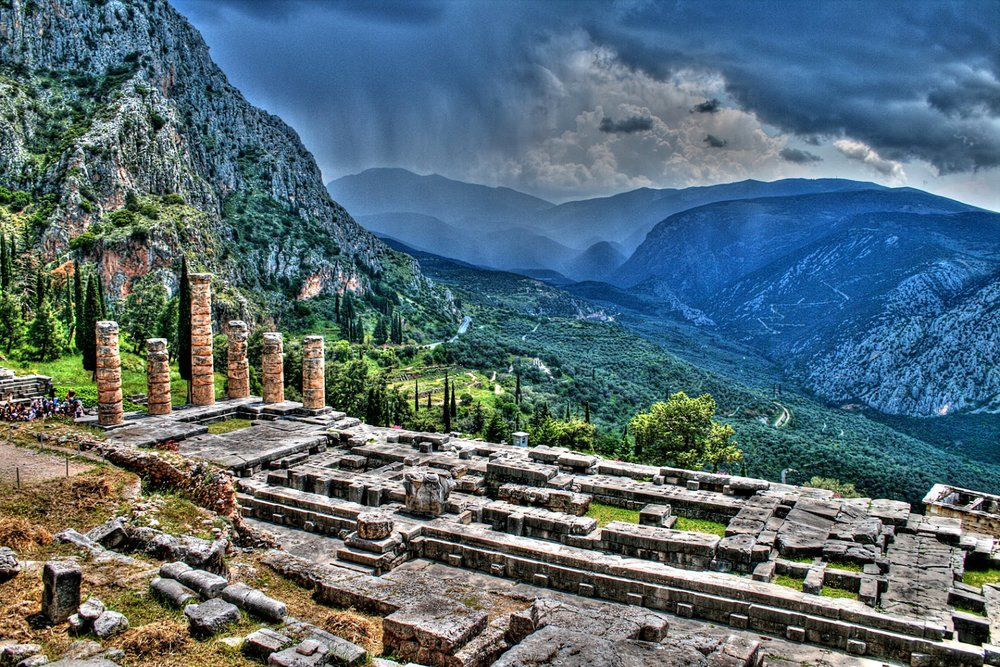ancient-ruins-of-delphi-and-the-sun-peaking-through-the-clouds.jpg