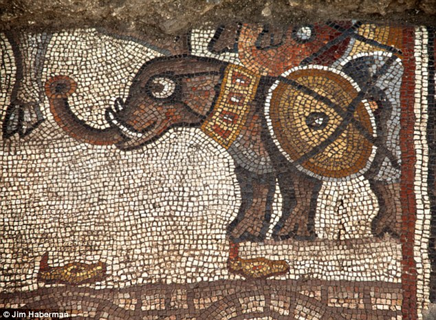 It's thought the warrior in the rare non-Biblical scene is Alexander the Great becaise of a procession of elephants (pictured). But Professor Magness said the identification of the figures in this mosaic is unclear because there are no stories in the Hebrew Bible involving elephants.