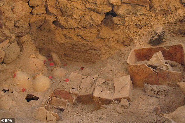 Pictured are marble and clay pots and other artefacts uncovered as part of the new study. The discovery was made by experts at the Greek culture ministry in the prehistoric village of Akrotiri - known locally as the 'Minoan Pompeii'