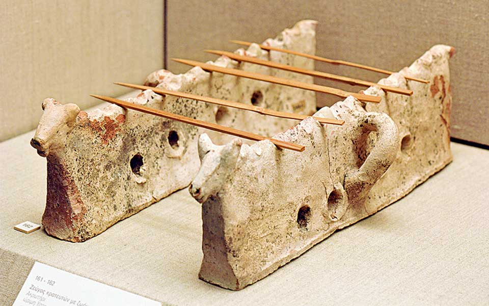"""Firedogs or """"souvlaki trays"""" with bulls-head finials, from Akrotiri, 17th c. BC (Archaeological Museum of Thera)."""