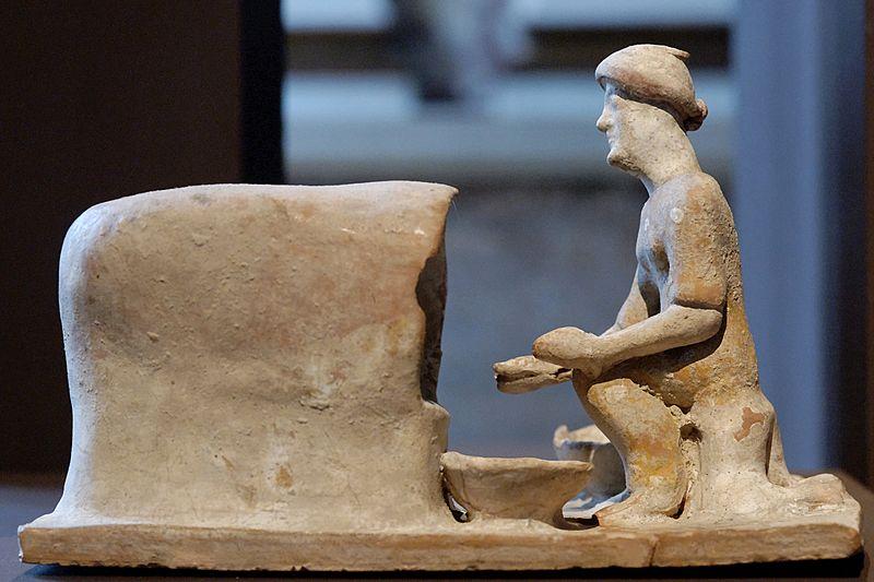 Greek woman baking bread (c. 5th century BC)