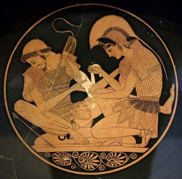 Achilles tending Patroclus wounded by an arrow, identified by inscriptions on the upper part of the vase. Tondo of an Attic red-figure kylix, circa 500 BC. From Vulci. (      Public Domain      )