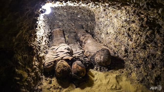 This picture taken on February 2, 2019 shows newly-discovered mummies wrapped in linen found in burial chambers dating to the Ptolemaic era (323-30 BC). (Photo: AFP/Mohamed El-Shahed)
