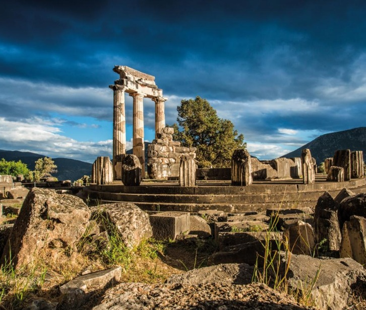 A GODDESS'S TEMPLE   This tholos, or circular temple, is located on the Marmaria terrace in Delphi, nearly half a mile from the sanctuary of Apollo. Part of a temple dedicated to Athena, goddess of wisdom, the columns standing today were reconstructed in 1938.   PHOTOGRAPH BY NAVÈ OGRAD/FOTOTECA 9X12
