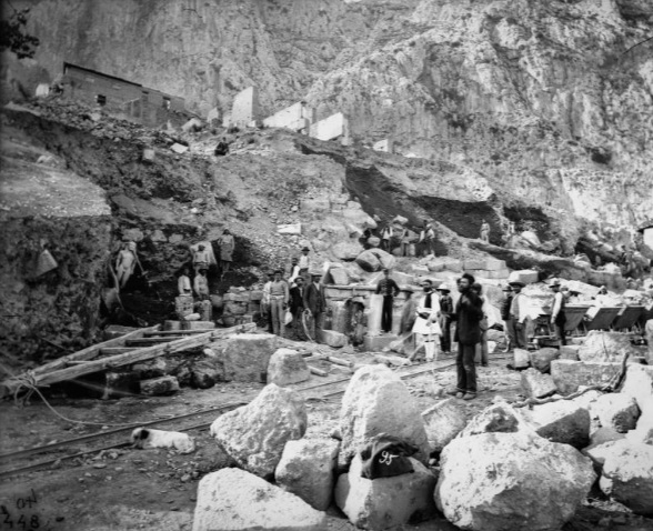 Homolle's team took this photograph on May 30, 1893, when the statue of Kleobis first emerged, largely intact, from the ground.  PHOTOGRAPH BY N.C./ÉCOLE FRANÇAISE D'ATHÈNES. MINISTRY OF CULTURE AND SPORTS/EPHORATE OF ANTIQUITIES OF PHOKIS