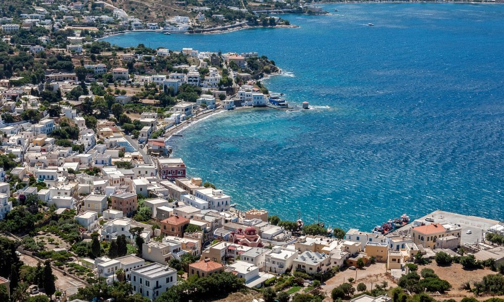 Bay watch … Alinda beach and the port of Agia Marina. Photograph: Alamy