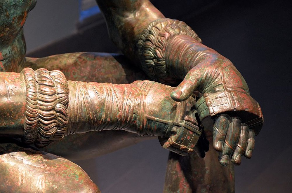 Boxer_of_Quirinal,_Greek_Hellenistic_bronze_sculpture_of_a_sitting_nude_boxer_at_rest,_100-50_BC,_Palazzo_Massimo_alle_Terme,_Rome_(13333064973).jpg
