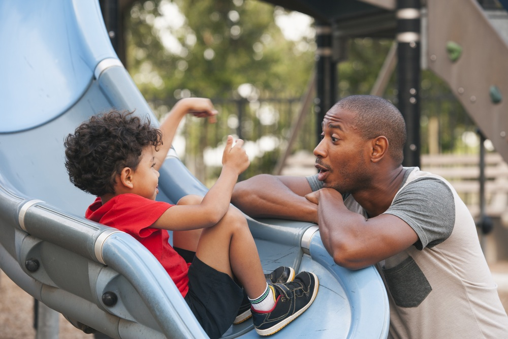 father-and-son-on-playground-470624237.jpg