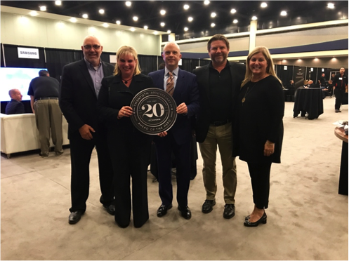 From L to R: Senior Vice President Jeff Willis, Senior Vice President Vendor Marketing Ashley Flaska, President & COO Kevin Kelly, Founder, Owner & CEO Mark Wilkins, and Vice President of Marketing Elizabeth Clune.