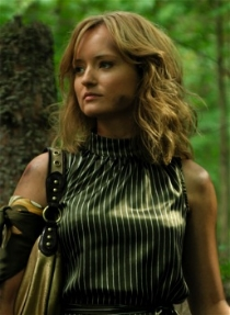 Shannon Beckner plays Andrea, the perky junior account exec with wilderness survival training.