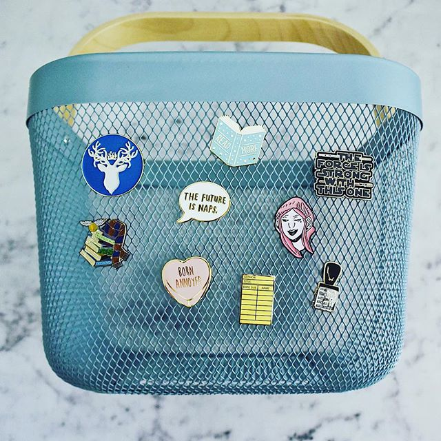 My burgeoning pin collection! Makers tagged (the blue one in the left corner is also @nerdy.post and the set at the bottom are both @outofprint). . . #enamelpin #enamelpins #bookishpins