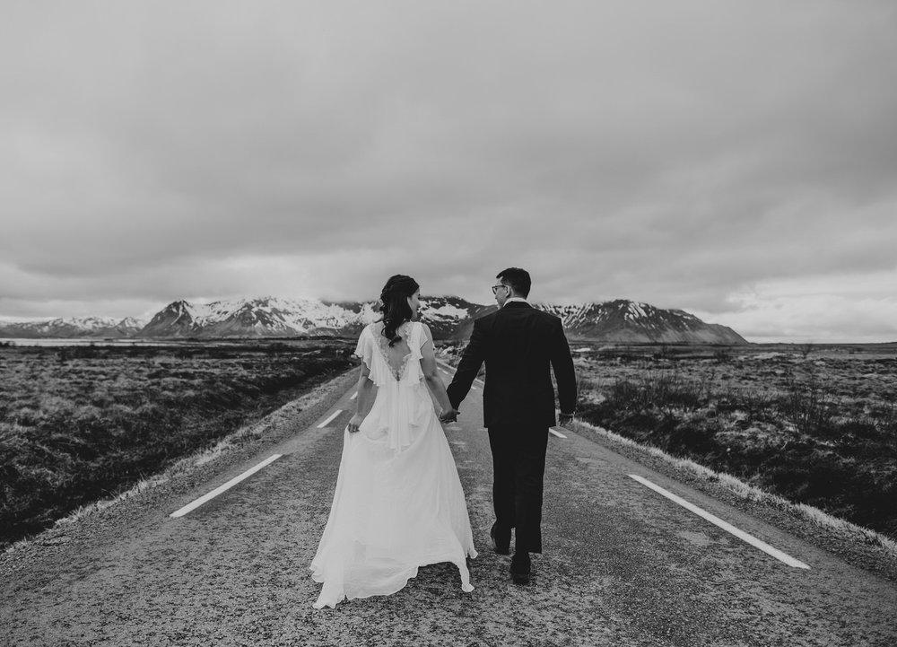 Empty road Lofoten Norway wedding couple