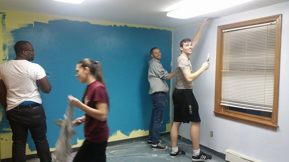 The EAG Youth Leaders painting the room where they have Youth Group on Wednesday Nights.