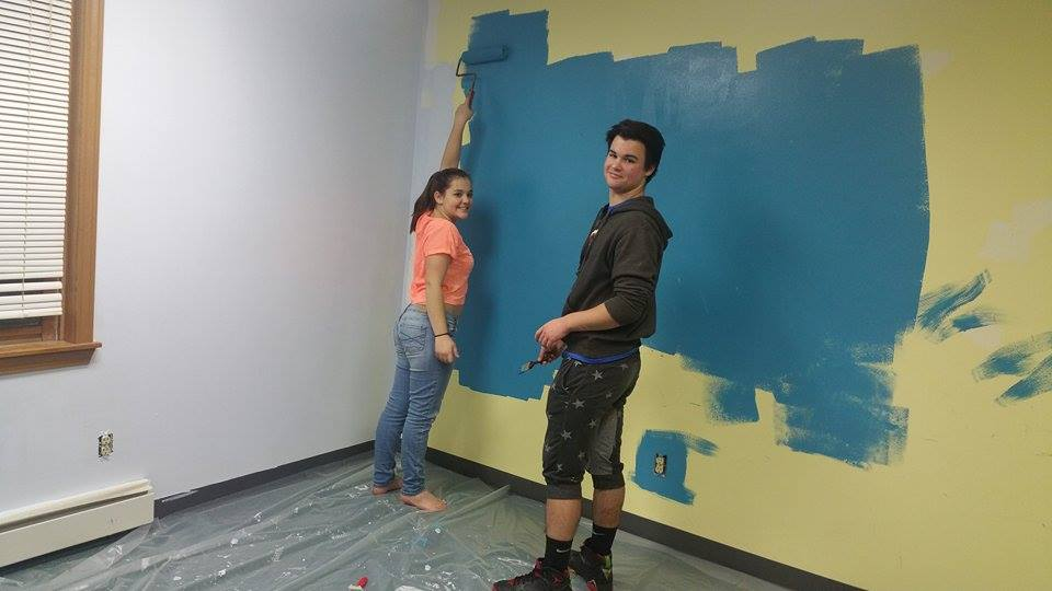 Hayden and Hannah painting their Youth room.