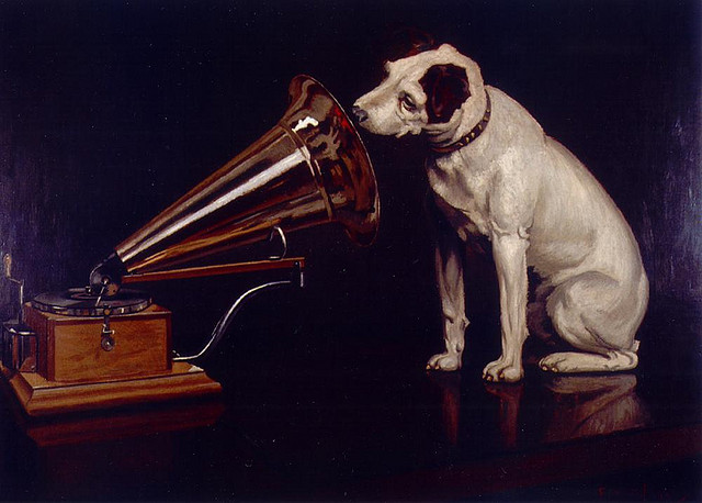 Dog-Looking-at-and-Listening-to-a-Phonograph-His-Masters-Voice-The-Original-RCA-Music-Puppy-Dog-Logo-Symbol-for-Advertising-by-Bevery-Pack.jpg