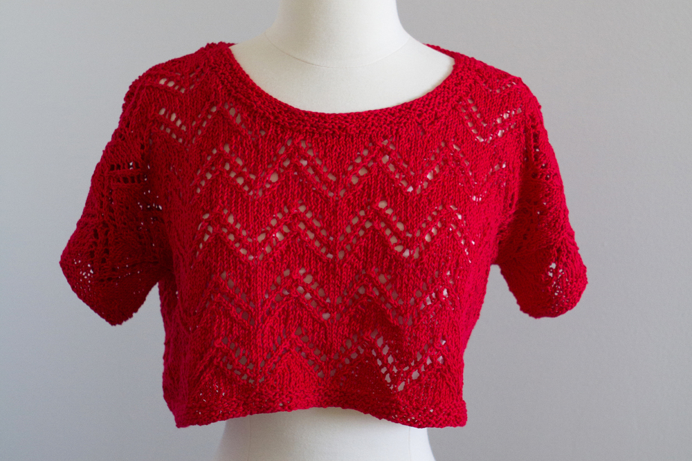 Zigzag pattern pull over with a red cotton yarn