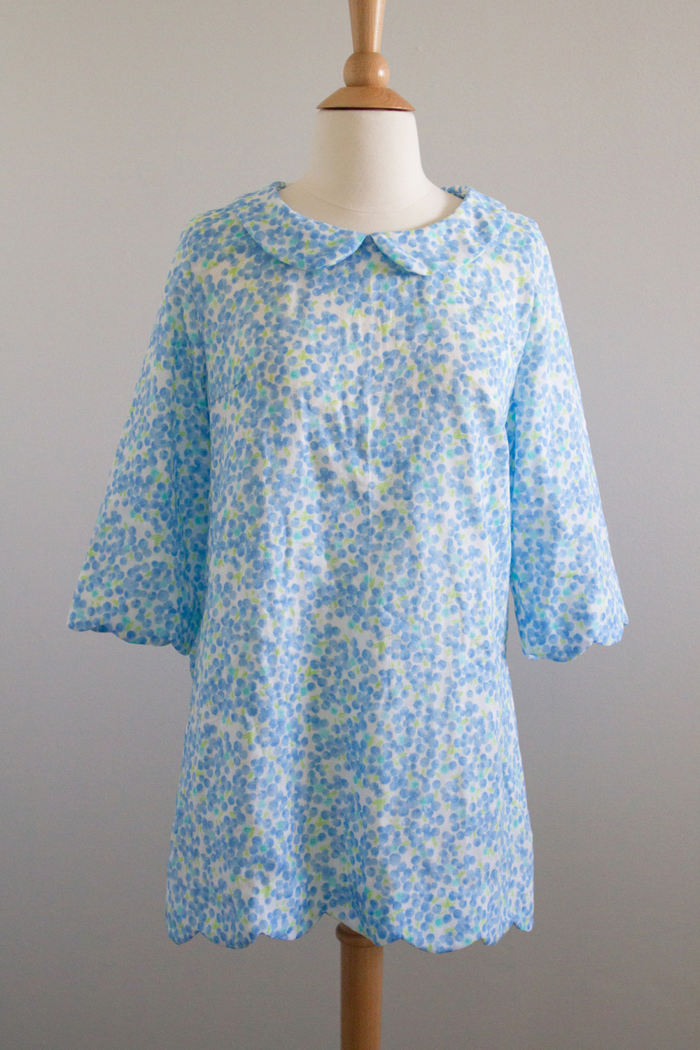 Blue shirt with scalloped hems