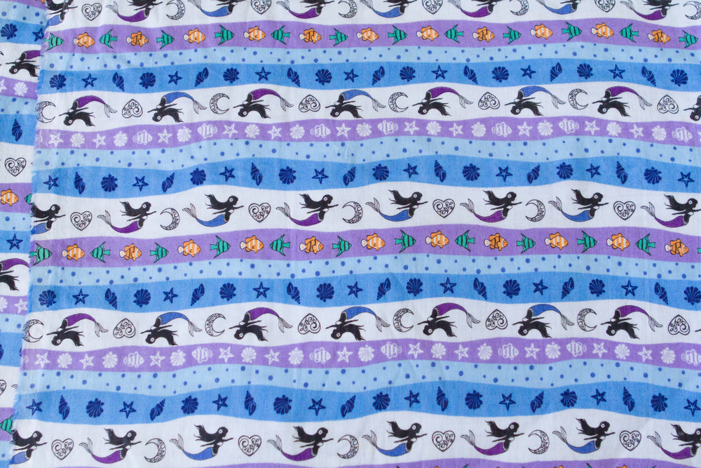 Soft double gauze with cute mermaid and tropical fish print