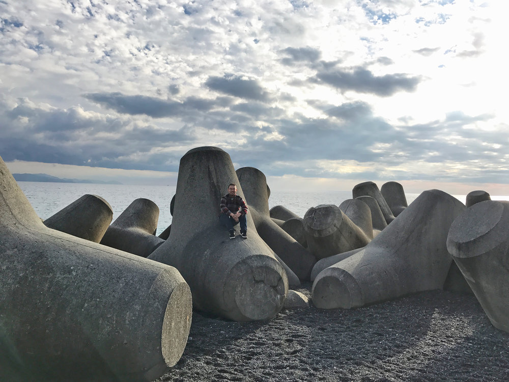 "Tagonoura Bay. These are called ""Tetrapods"" and one of their purpose is to prevent coastal erosion."