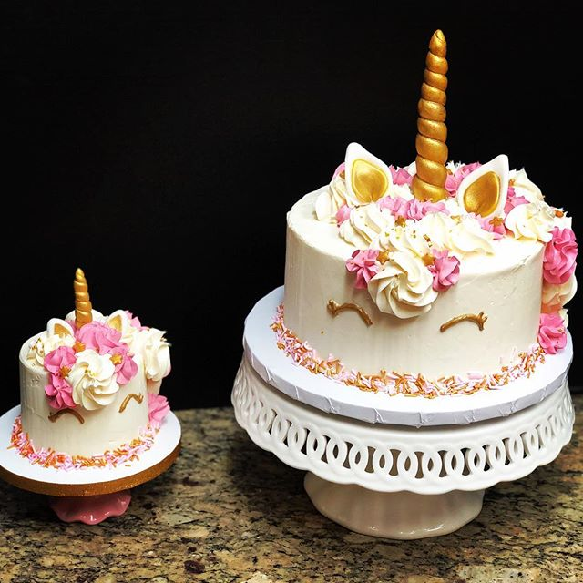 A mama unicorn cake and a baby unicorn smash cake for a sweet baby's birthday! . Sweet strawberry cake is filled with vanilla buttercream and decorated with golden fondant horns and little ears! . #babybirthday #sweets #cake #birthdaycake #cakestagram #unicorncake #unicorn #strawberry #strawberrycake #vanilla #vanillabuttercream #macaronsbylynn #buttercream #baking #bake #fondant #sprinkles #fancysprinkles #goldstars #yum #desserts #alicorn #thanks #foulmouthedfitness #forssharingthatduringclass