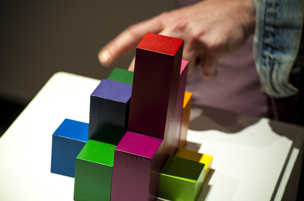 Viewers interact with colored blocks to create sound