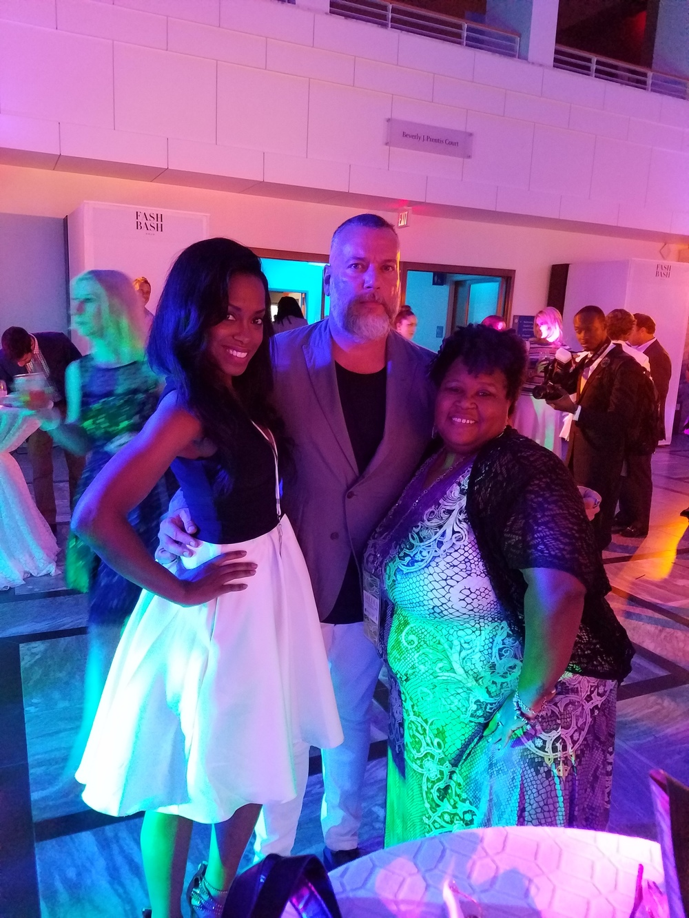 Member of Fashion Group Int. (FGI) Latrice Delgado-Macon, Jeff Newsom and Lisa Benedict