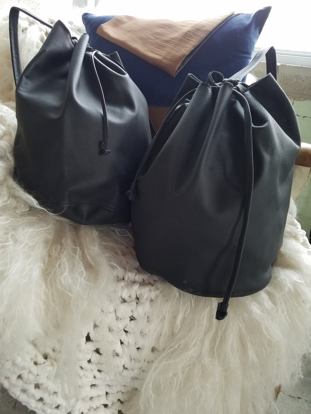 Leather bags and bag packs made by Leslie for the BLANK ITTI BLANK collection,