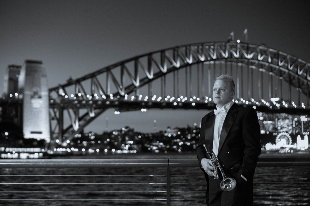 Phill O'Neill Standing in front of the Sydney Harbour Bridge