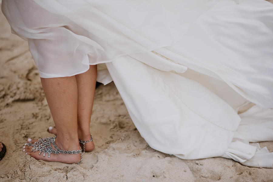 Bride in Dress and Shoes on Beach