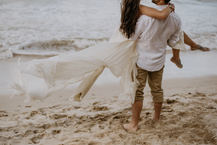 Couple Standing on the Beach in Hawaii