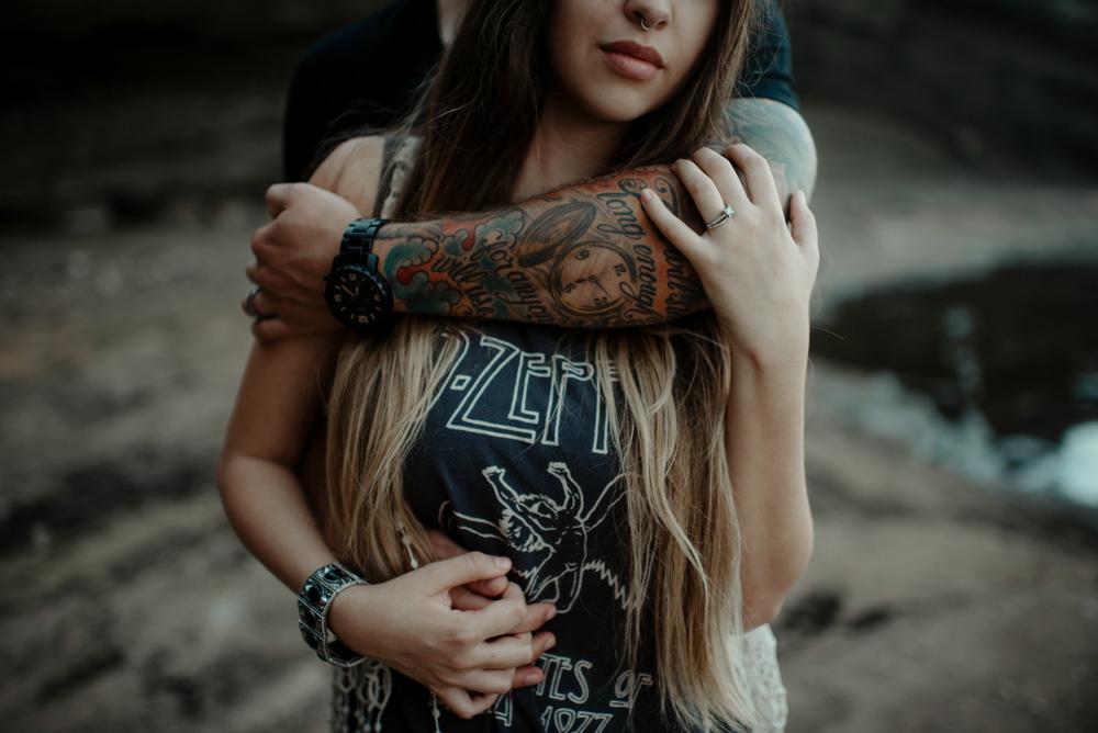 Man with Tattoo Hugging Girl