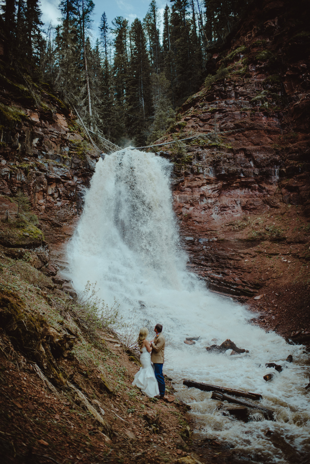 Wedding Picture of Couple by Waterfall