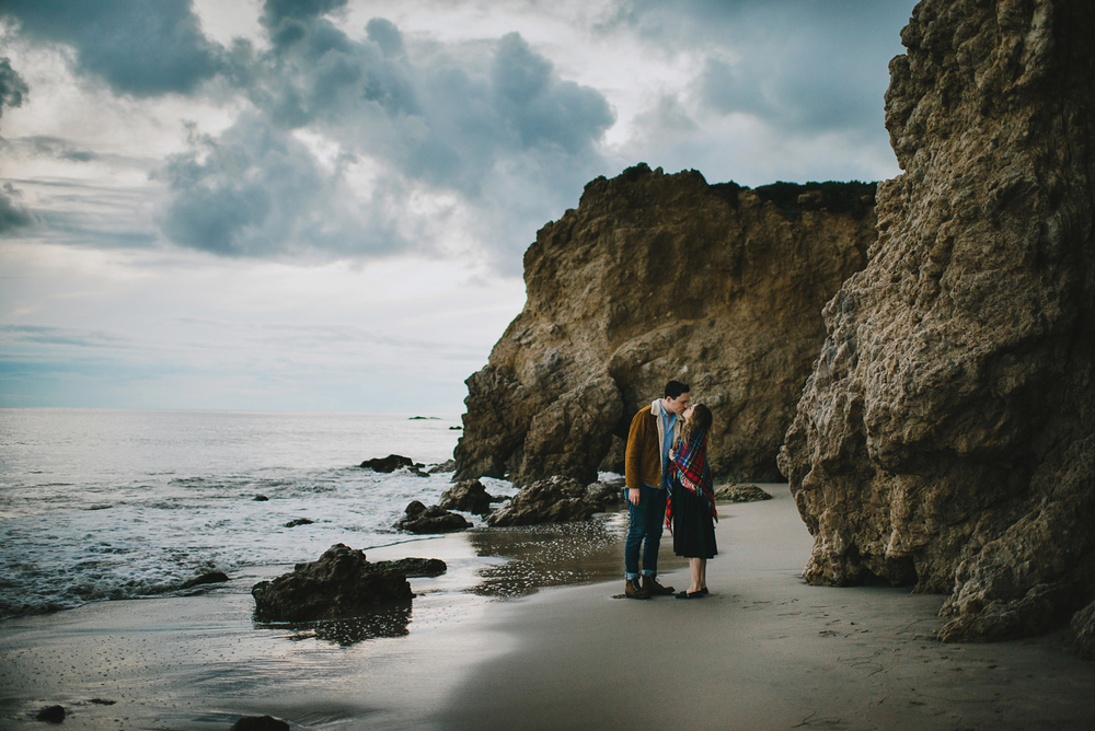 Couple Kissing on The Beach Engagement Photo