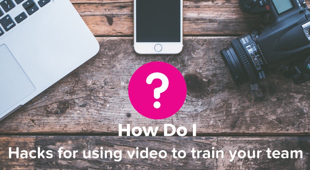 The How Do I logo (a pink circle with a white question mark) is surrounded by a Macbook, iPhone and camera. The caption below says Hacks for using video to train your team.