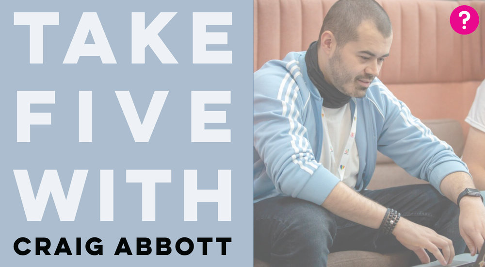 Craig Abbott is pictured in a blue long sleeved shirt typing on a laptop, the caption on the left hand side of him says 'Take Five with Craig Abbott'
