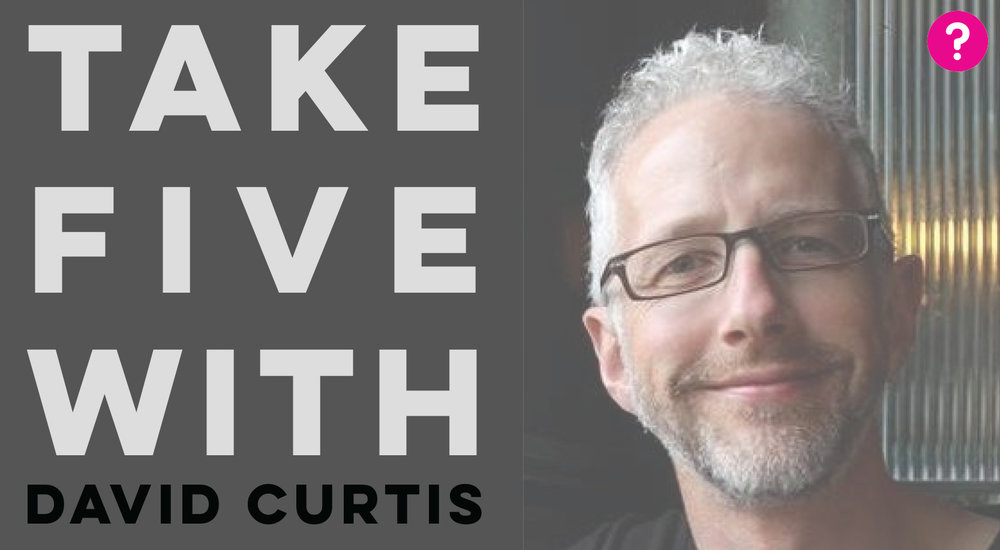 Take Five With - David Curtis - Pictured is a closeup of David smiling into the camera
