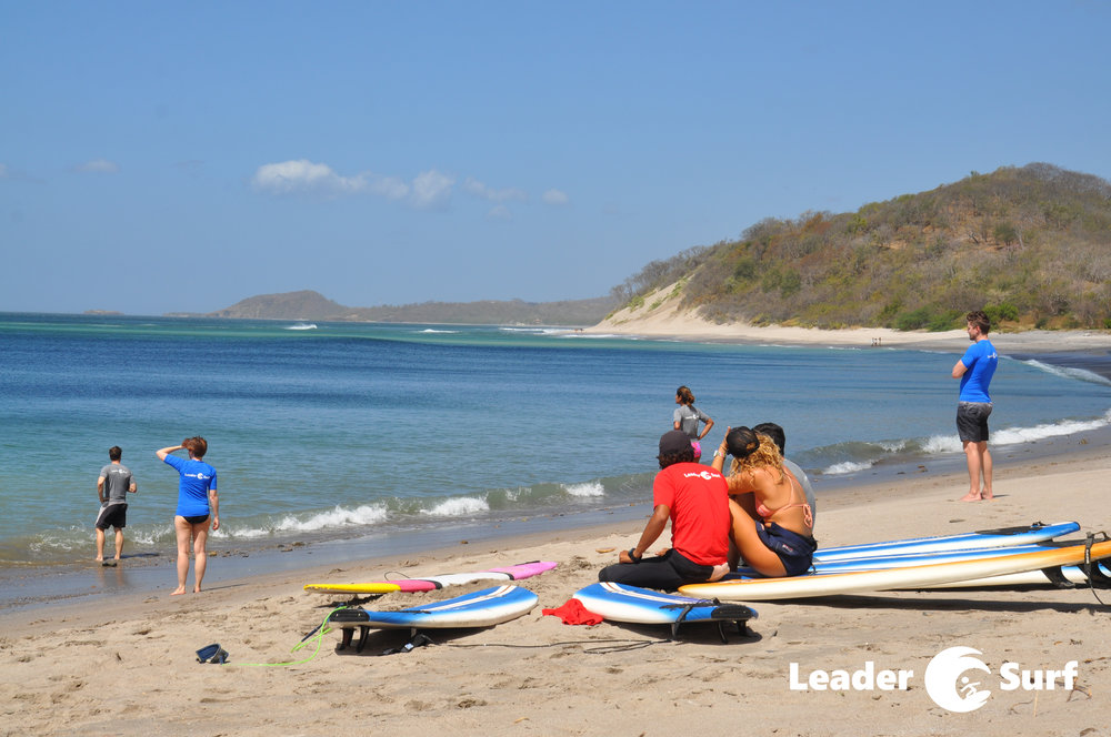 LeaderSurf participants studying the ocean before entering it