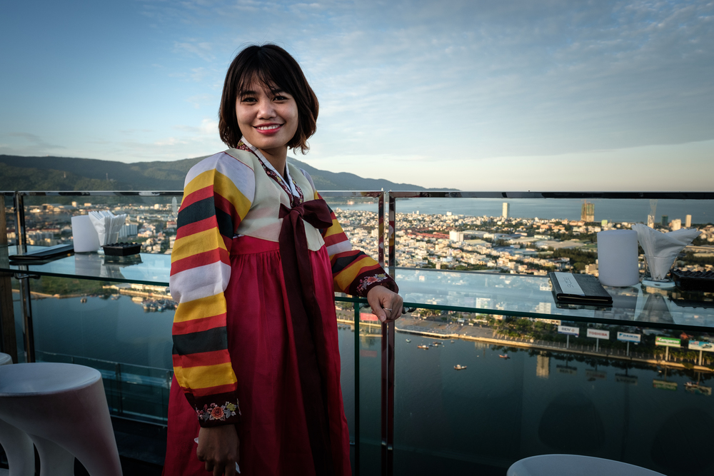 Korean night on the rooftop - hostess Hoang Hai at Skybar 36, wearing traditional Korean clothes.