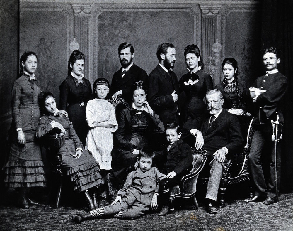 Freud family c.1876. Standing left to right: Paula, Anna, Sigmund, Emmanuel, Rosa and Marie Freud and their cousin Simon Nathanson. Seated: Adolfine, Amalia, Alexander and Jacob Freud. Hulton Archive/Getty Images