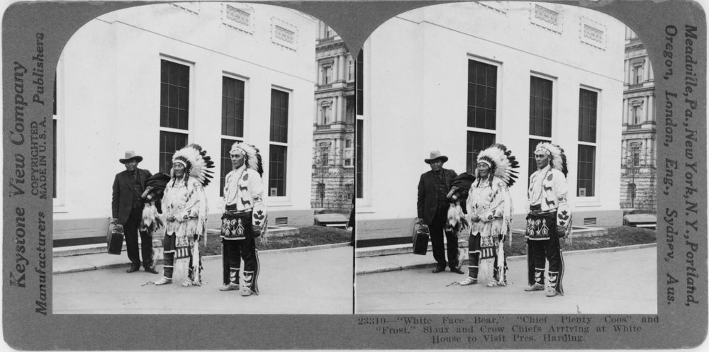 """White Face Bear,"" ""Chief Plenty Coups"" and ""Frost,"" arriving at White House to visit President William G. Harding. Keystone View Company, stereo card, c. 1921. Library of Congress"